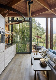 A Floating South African Cabin Borrows From the Landscape - Photo 4 of 9 - The kitchen features elm cabinets made by Valcucine in Italy.