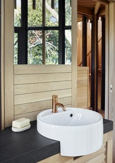 A Floating South African Cabin Borrows From the Landscape - Photo 5 of 9 - The bathroom tap is by Vola and the sink is by Ceramica Flaminia.