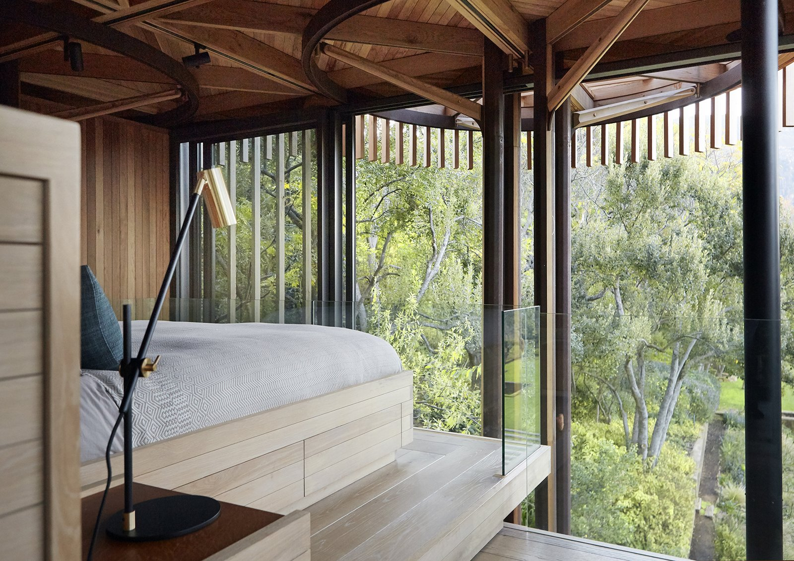 Graham can also enjoy the view from his room. Tagged: Bedroom, Table Lighting, Light Hardwood Floor, and Bed.  Photo 6 of 9 in A Floating South African Cabin Borrows From the Landscape