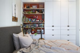 A Southern Californian Prefab Is Paradise For the Whole Family - Photo 6 of 11 - Built-in storage keeps things organized in Leo's bedroom, which contains an Ella bed from Room & Board and an Inmod duvet.