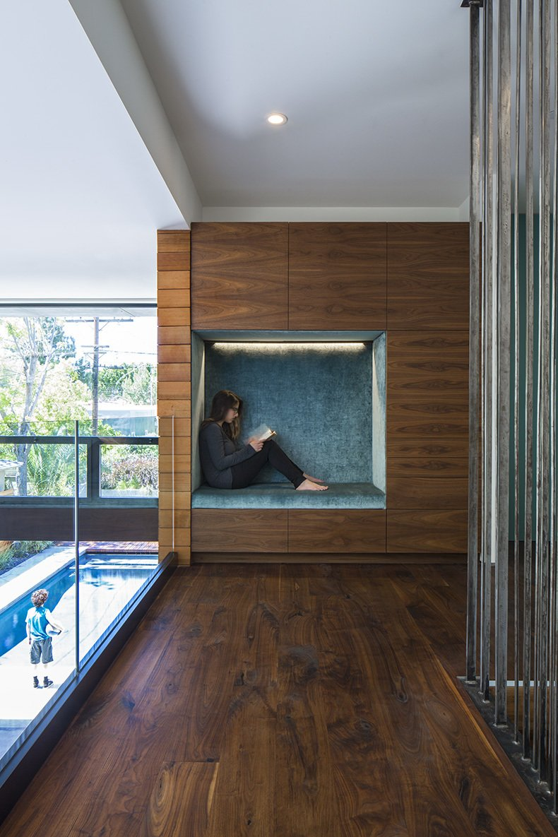 The second-floor niche, which is lined in Osborne & Little fabric, offers a quiet getaway. Tagged: Hallway and Medium Hardwood Floor.  Photo 10 of 12 in A Southern Californian Prefab Is Paradise For the Whole Family
