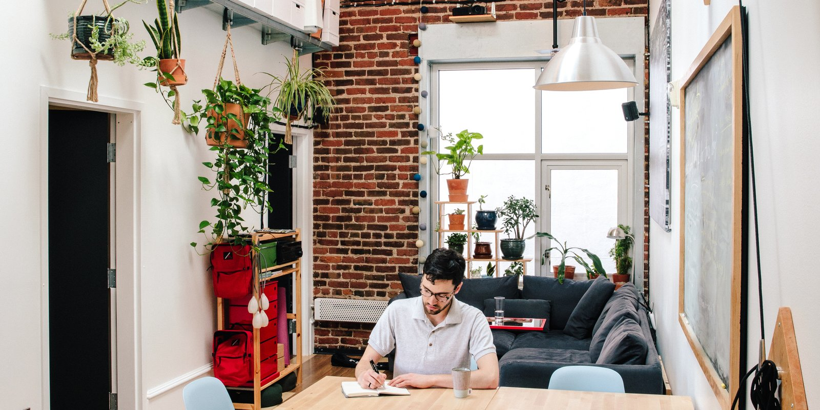 A software engineer outfits his tiny apartment with flexible design ideas.  Max's modestly scaled loft, for which he designed and made many of the furnishings, sits on the top floor of a 1908 building that went condo in 2006, offering homeowners a no-frills berth in the heart of San Francisco's downtown. Just outside the front door awaits a dizzying array of shops, theaters, and corporate offices, including Twitter's, as well as a robust population of street denizens. Tagged: Living Room, Ceiling Lighting, and Sofa.  Max's Apartment by Dwell from Devising Clever Solutions For a Small San Francisco Loft