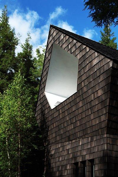 Cedar shingles wrap the exterior.
