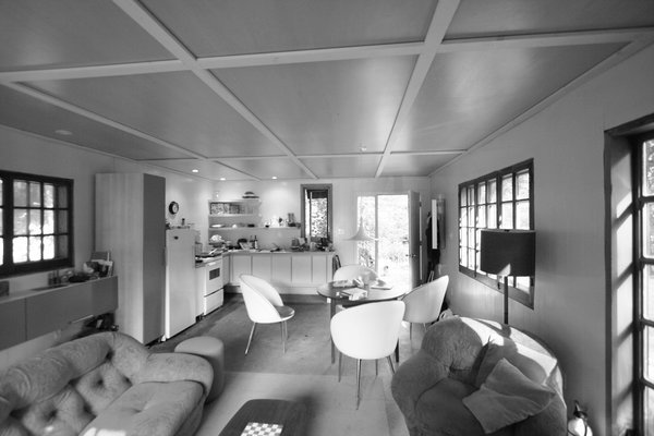 Suzanne Rochon bought the cabin in 2002 and spent a decade fixing it up before calling on YH2 Architecture. In 2005, she added five acres, doubling the property. Photo 10 of La Colombière modern home