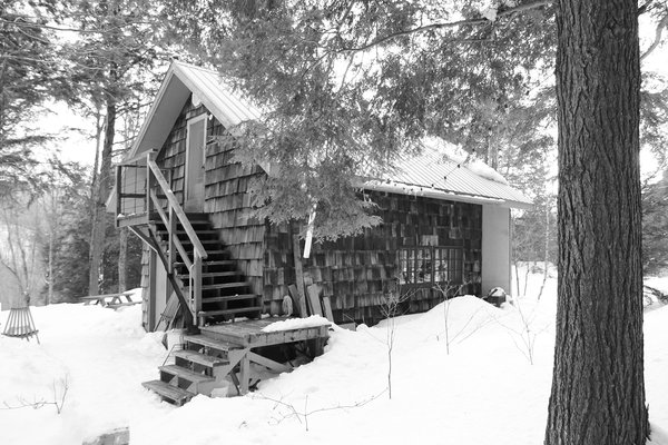 By building upward and outward, YH2 Architecture added to a former lumberman's shed without harming the nearby trees. Photo 2 of La Colombière modern home