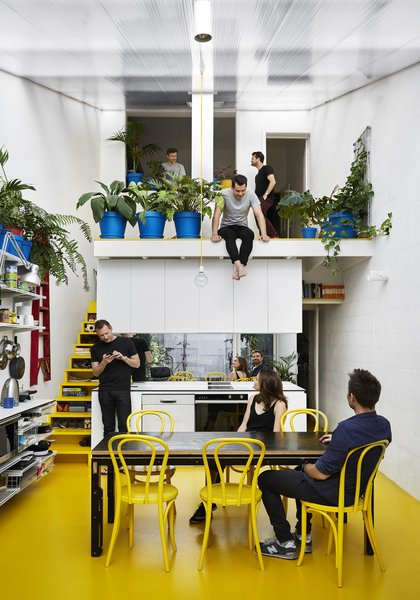 In an attempt to beat the winter blues and improve his work/life balance, Australian architect Andrew Maynard combines his home with his office in a sun-drenched Victorian terrace with bright bursts of yellow. In 2016, architect Andrew Maynard of Austin Maynard Architects (AMA) decided to transform the way he and his team live and work. At the end of winter, Maynard visited a doctor about his increasing levels of stress and anxiety. The doctor's suggestion was that he get more vitamin D to improve his mental health. Maynard decided to radically renovate his dark, Victorian-style terrace house in Melbourne, and flood it with therapeutic sunshine.