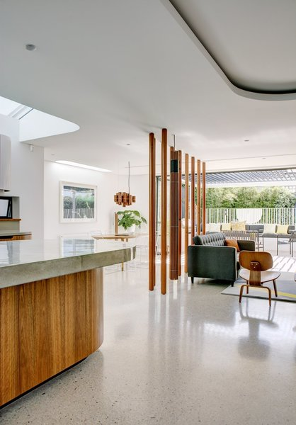 Modern home with living room, chair, sofa, and pendant lighting. Photo  of Conway Atkins House