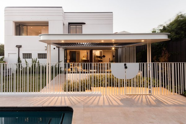 Modern home with outdoor, front yard, trees, stone patio, porch, deck, and metal fence. Photo 2 of Conway Atkins House