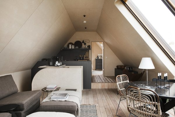 Modern home with living room, chair, table, sofa, table lighting, and light hardwood floor. Photo 2 of Coastal Barn