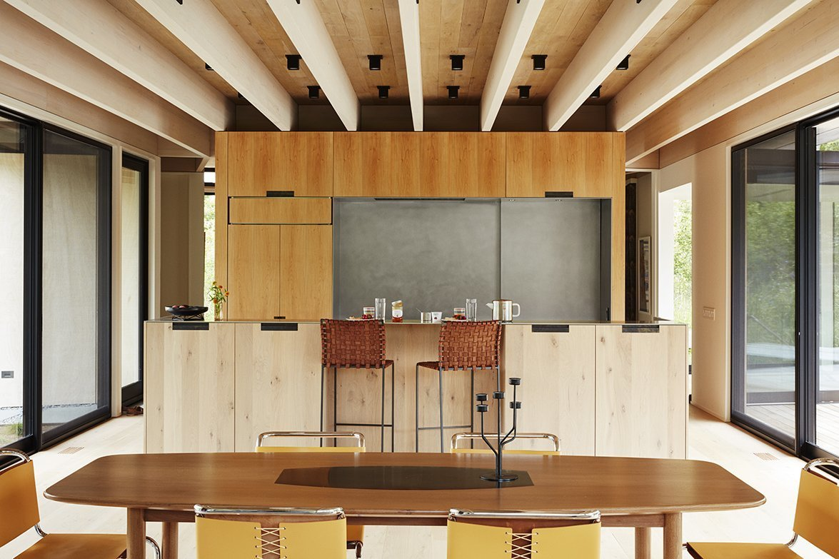 Tagged: Kitchen, Light Hardwood Floor, Ceiling Lighting, Wood Cabinet, Refrigerator, and Cooktops.  Promised Land by Dwell