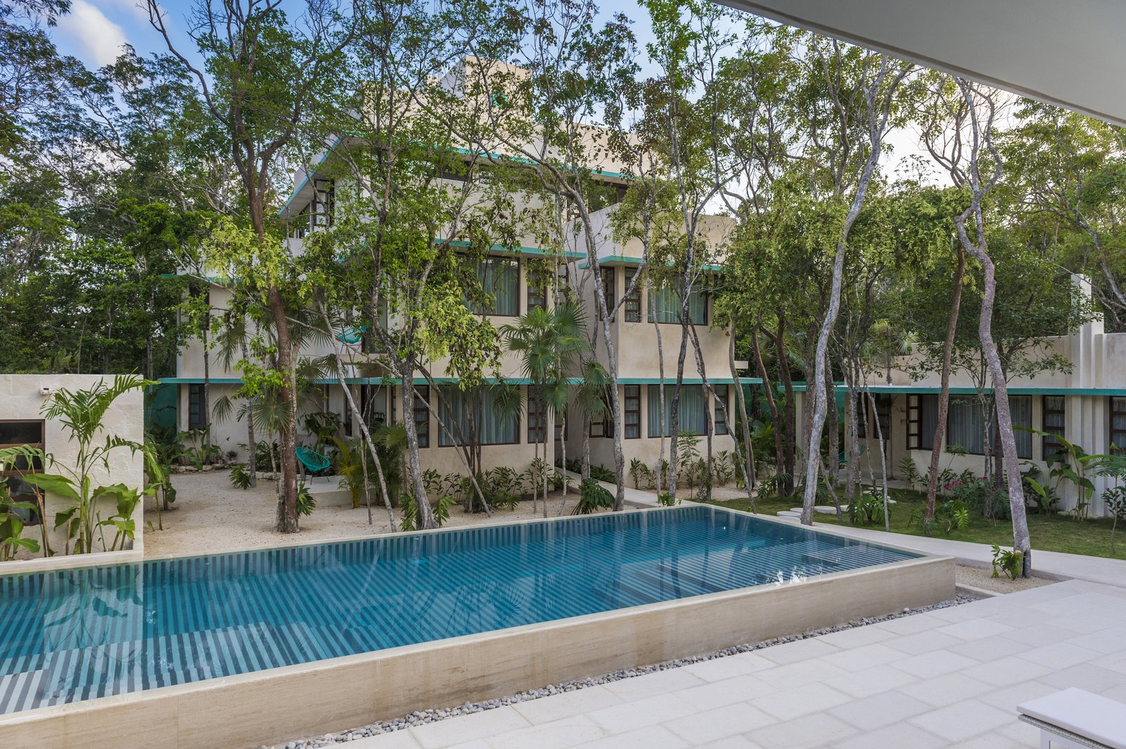 Tagged: Outdoor, Back Yard, Trees, Large Pools, Tubs, Shower, and Swimming Pools, Tubs, Shower.  Photo 4 of 9 in A New Modern Hotel Brings Midcentury Miami to Tulum, Mexico