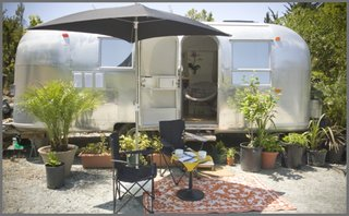 """8 Ways to Renovate an Airstream - Photo 8 of 8 - """"I found the Airstream in the high desert of Anza, California, and thought it was a pure TLC job. Wishful thinking!"""" says interior designer Caroline Brandes, who also rents renovated Airstreams on her property in Big Sur through Big Sur Getaway. """"Even though the interior looked decent, once back home in Big Sur I had discovered water leaks, extensive floor rot under the linoleum tiles, and even frame damage."""" She hired Area 63 Productions, a professional Airstream renovation company, to help."""