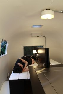 8 Ways to Renovate an Airstream - Photo 6 of 8 - Much like traditional Japanese futon beds, the mattress hidden in the table folds out for a softer place to sleep.