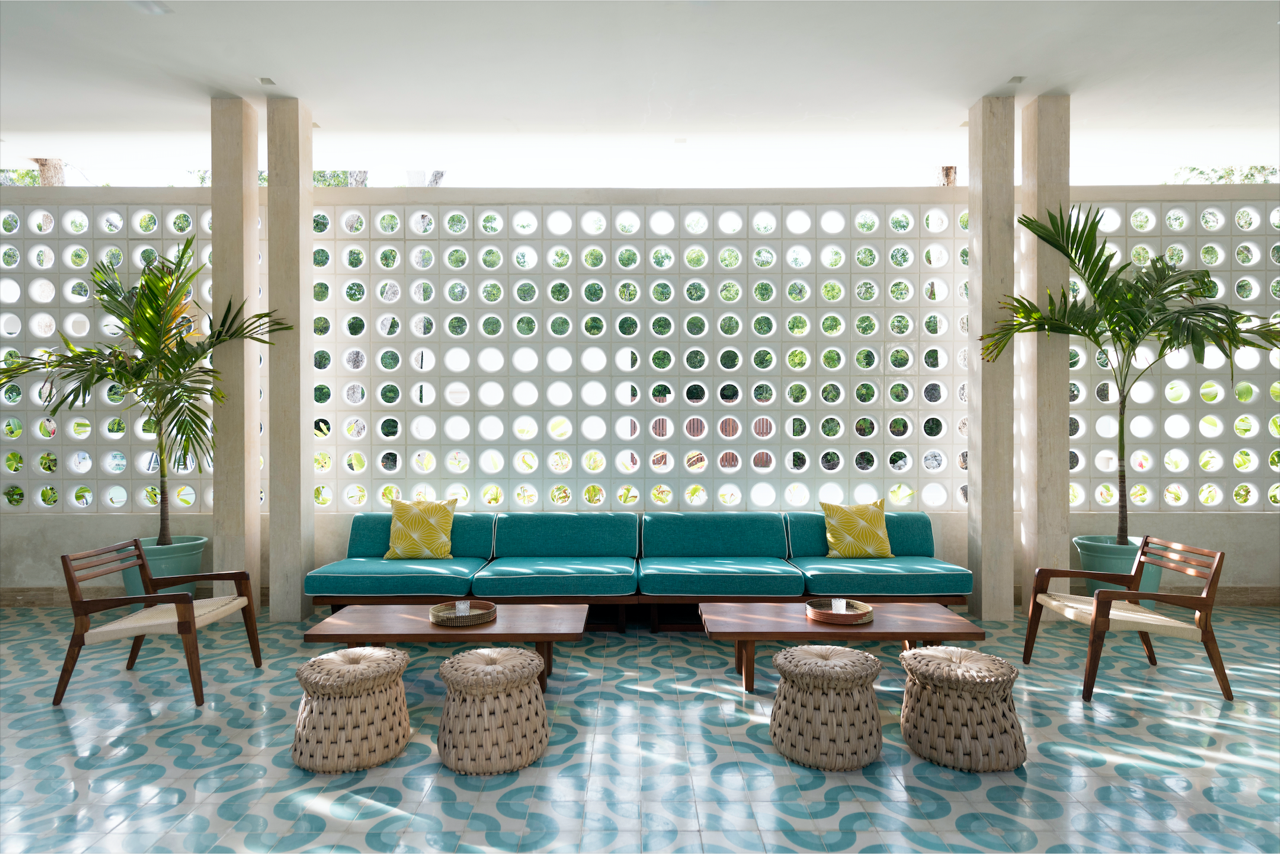 """I love the art deco architecture of Miami Beach and all the midcentury buildings. We're not that far away from Miami, so I thought if that architecture works very well over there and we have the exact same climate, why not bring that kind of architecture and revive it in Tulum,"" says Haag, who kept design-savvy travelers in mind while developing the hotel.  Tagged: Living Room, Chair, Bench, Coffee Tables, and Ceramic Tile Floor.  Photo 7 of 9 in A New Modern Hotel Brings Midcentury Miami to Tulum, Mexico"