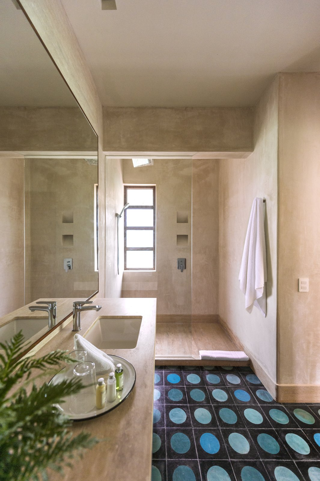 Tagged: Bath Room, Stone Counter, Ceramic Tile Floor, Undermount Sink, and Open Shower.  Photo 6 of 9 in A New Modern Hotel Brings Midcentury Miami to Tulum, Mexico