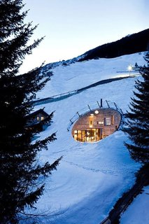 Dwell's Top 10 Vacation Homes of 2017 - Photo 9 of 10 - Villa Vals, a four-bedroom vacation rental in the stunning Alpine village of Vals, Switzerland, is not your conventional ski resort home.  Completed in 2009, this unusual villa that's available for rent through Boutique Homes, is embedded into the hillside, making most of its functional spaces subterranean. A dramatically-recessed shape gives the villa the quality of a modern art installation, while the organic shape of its central terrace—the only part of the house that can be seen from the outside—seems to meld with the natural landscape.