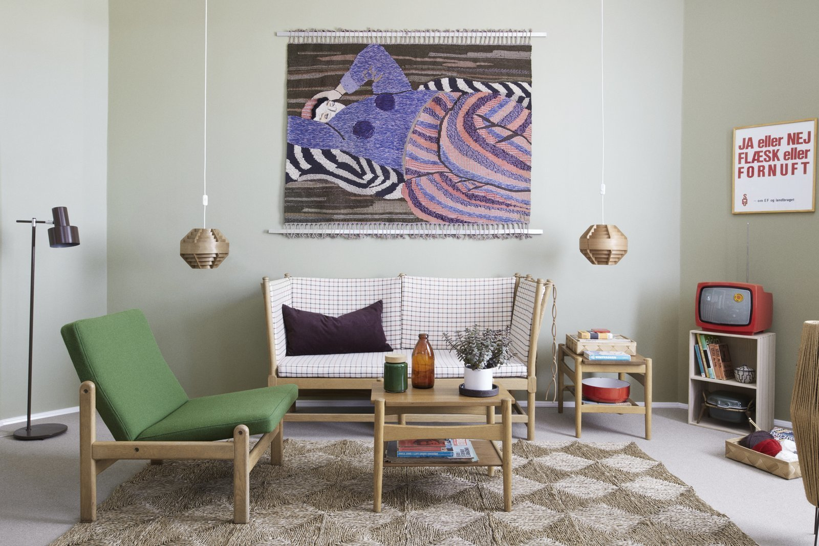 Tagged: Living Room, End Tables, Chair, Coffee Tables, Rug Floor, Pendant Lighting, and Sofa.  Photo 1 of 9 in Get Your Fix of Midcentury Scandinavian Design at This Copenhagen Hotel