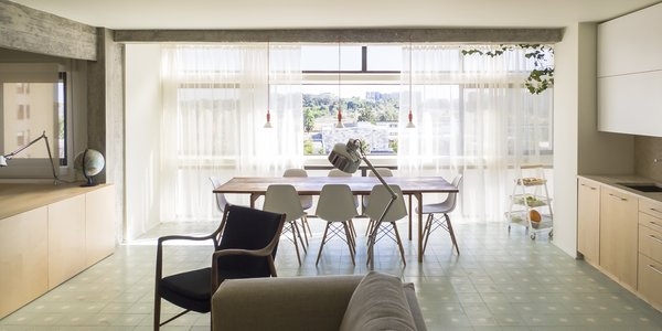 - Lisbon, Portugal Dwell Magazine : July / August 2017 Tagged: Dining Room, Chair, Table, Ceramic Tile Floor, and Ceiling Lighting.  The Henriques/Moreira Residence by Dwell from Lisbon Vision