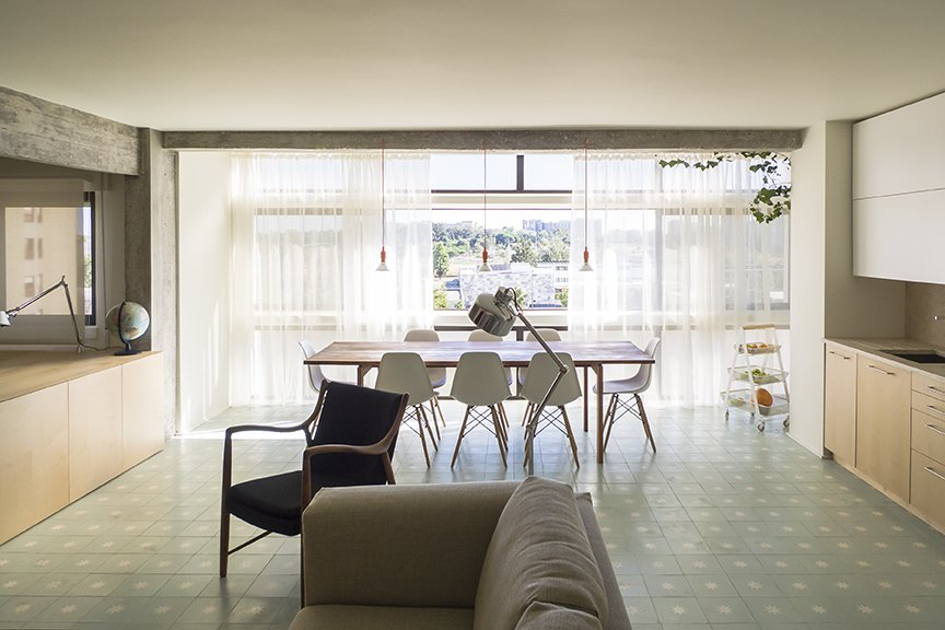 He also opted for light-colored materials, like seafoam-green cement tile by Projecto Mosaico and birch plywood millwork. Tagged: Dining Room, Table, Chair, Ceramic Tile Floor, and Pendant Lighting.  The Henriques/Moreira Residence by Dwell from Lisbon Vision