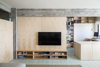 Lisbon Vision - Photo 3 of 5 - The living room is defined by a large birch plywood television console, designed by architect, Miguel Marcelino.