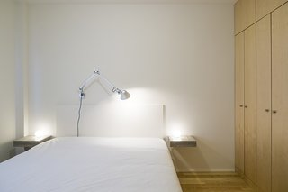 Lisbon Vision - Photo 4 of 5 - The bed, nightstands, and cabinets were all designed by Miguel Marcelino. The Glo-Ball bedside lamps are by Jasper Morrison and the Tolomeo wall lamp is by Michele De Lucchi.