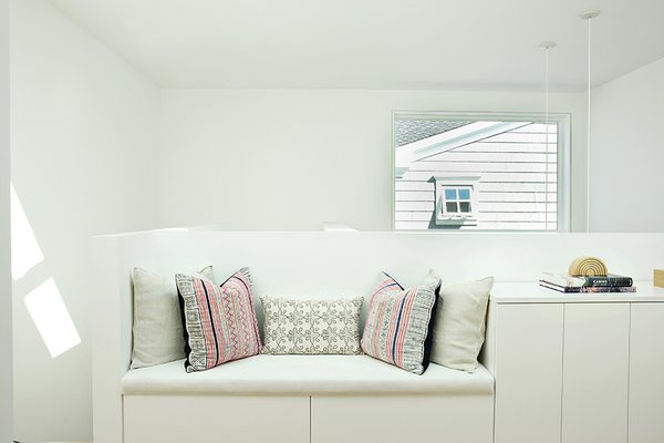 The upstairs corridor features a custom bench and cushions. Large skylights provide an abundance of natural light.