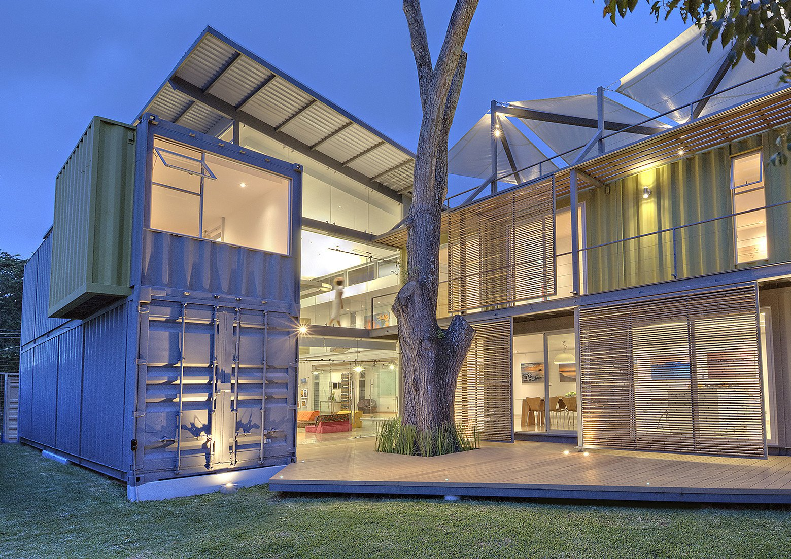 Tagged: Outdoor, Decking Patio, Porch, Deck, Trees, and Grass.  Photo 1 of 11 in Who Knew a Relaxing Tropical Retreat Could Be Made of Shipping Containers?