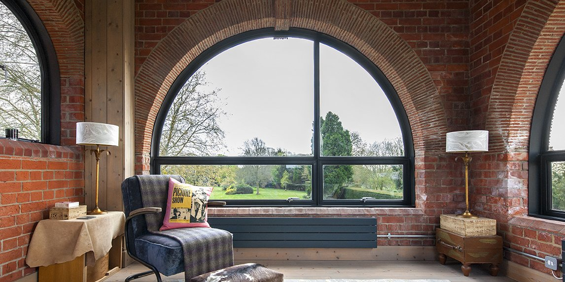 - Fritham, England Dwell Magazine : July / August 2017 Tagged: Living Room, Chair, End Tables, Light Hardwood Floor, Table Lighting, and Lamps.  Lister Tower by Dwell from A Refurbished, Victorian-Era Brick Tower in Hampshire