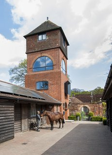 A Refurbished, Victorian-Era Brick Tower in Hampshire - Photo 1 of 9 - In Fritham, England, Andrew Hollins and Sheryl Wilson repaired a water tower with the help of PAD Studio. An adjoining cottage containing bedrooms, a kitchen, and more is outfitted with LG solar panels.