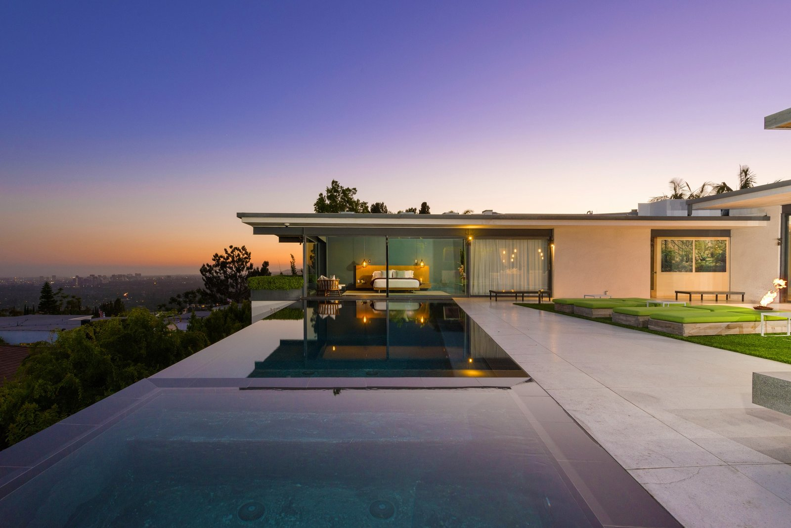 Tagged: Outdoor, Back Yard, Trees, Hardscapes, Infinity Pools, Tubs, Shower, and Large Patio, Porch, Deck.  Photo 1 of 11 in 'Friends' Star Matthew Perry's Midcentury Stunner in the Hollywood Hills Is For Sale