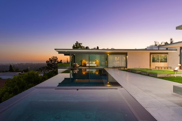 Modern home with outdoor, back yard, trees, hardscapes, infinity pool, and large patio, porch, deck. Photo  of Hopen Place
