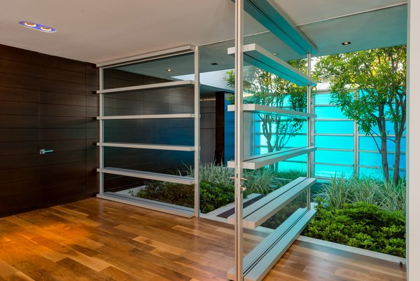 Modern home with medium hardwood floor, windows, and metal. Photo 6 of Hopen Place