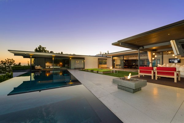 Modern home with outdoor, back yard, grass, infinity pool, large pool, and large patio, porch, deck. Photo 3 of Hopen Place