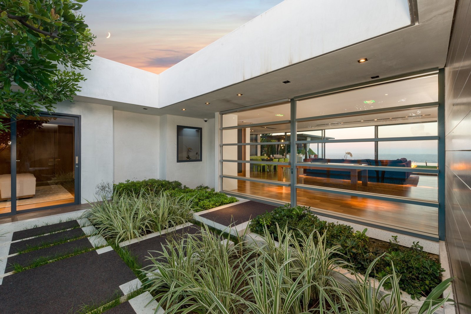 Tagged: Outdoor, Front Yard, Shrubs, Hardscapes, and Pavers Patio, Porch, Deck.  Hopen Place by Dwell from 'Friends' Star Matthew Perry's Midcentury Stunner in the Hollywood Hills Is For Sale