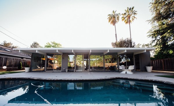 Modern home with outdoor, trees, back yard, stone patio, porch, deck, small pool, and wood fence. Photo 2 of Renovated Sunnyvale Eichler