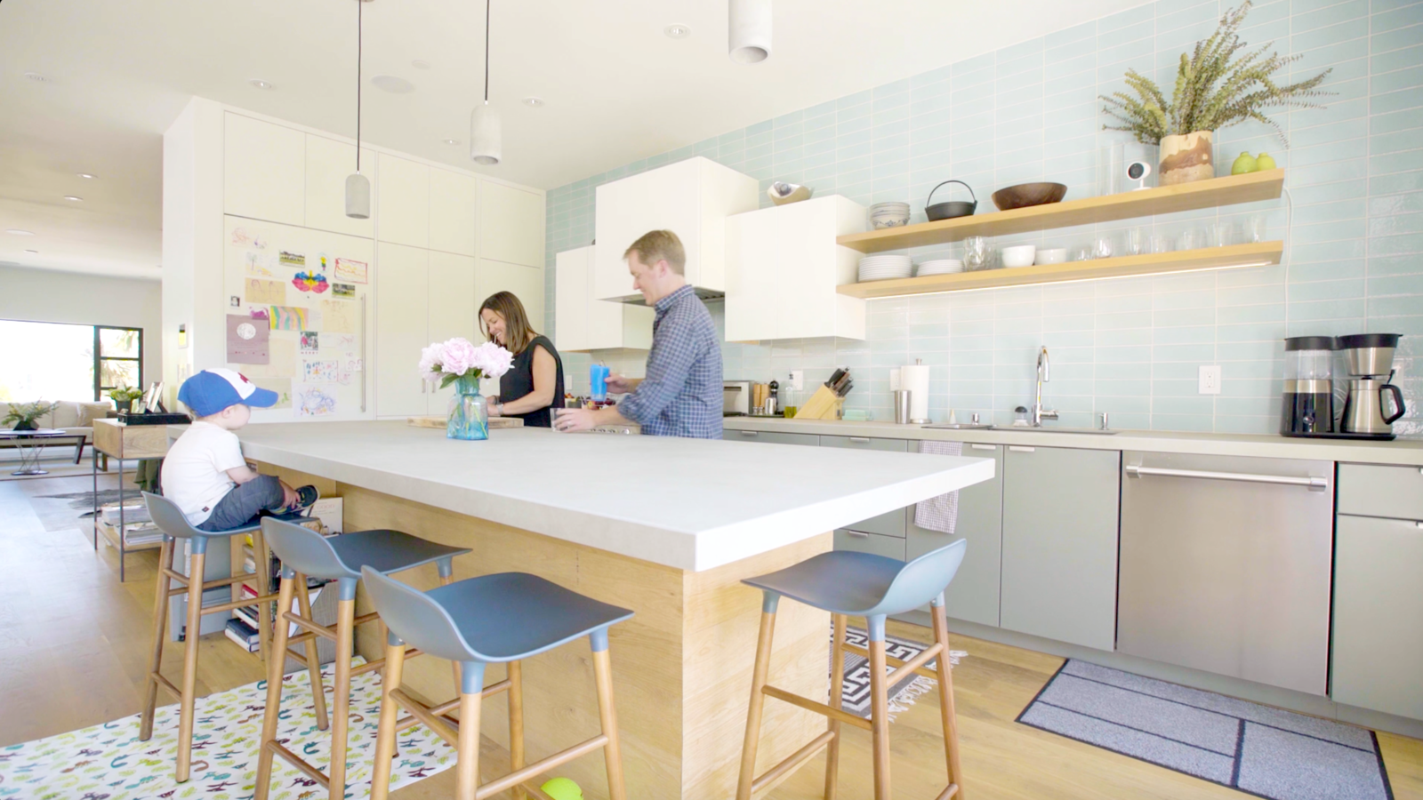 """Sometimes you catch hilarious moments when you're watching them with Nest Cam IQ,"" says Cameron.* Tagged: Kitchen, Pendant Lighting, Colorful Cabinet, and White Cabinet.  Best Photos from Revamping the San Francisco Vernacular, Modern Design and Technology Serves A Busy Family"