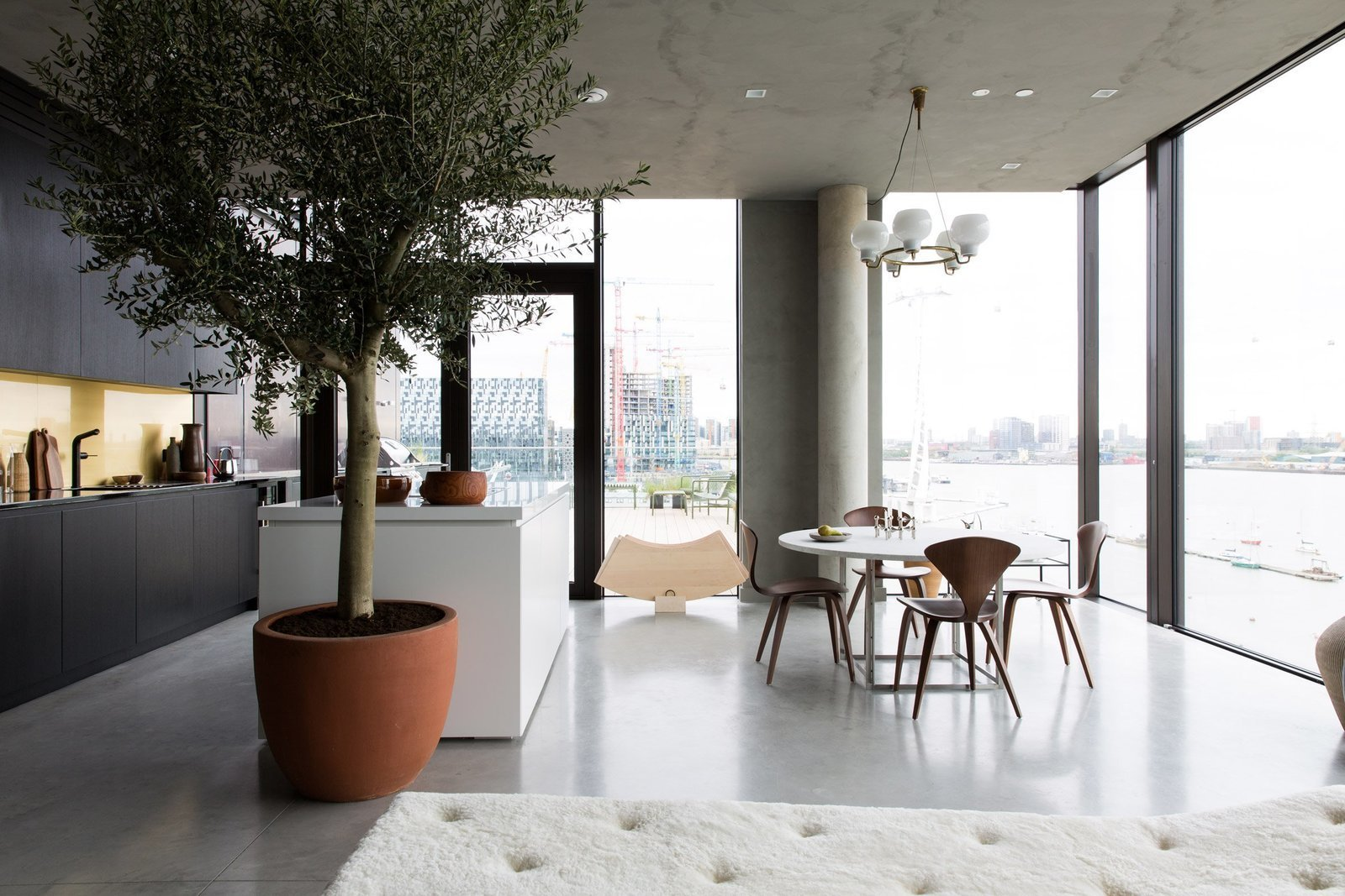 Tagged: Dining Room, Table, Chair, Pendant Lighting, Concrete Floor, and Recessed Lighting.  Photo 2 of 13 in For Just Under $2 Million, You Could Live in a London Penthouse Outfitted by Cereal Magazine