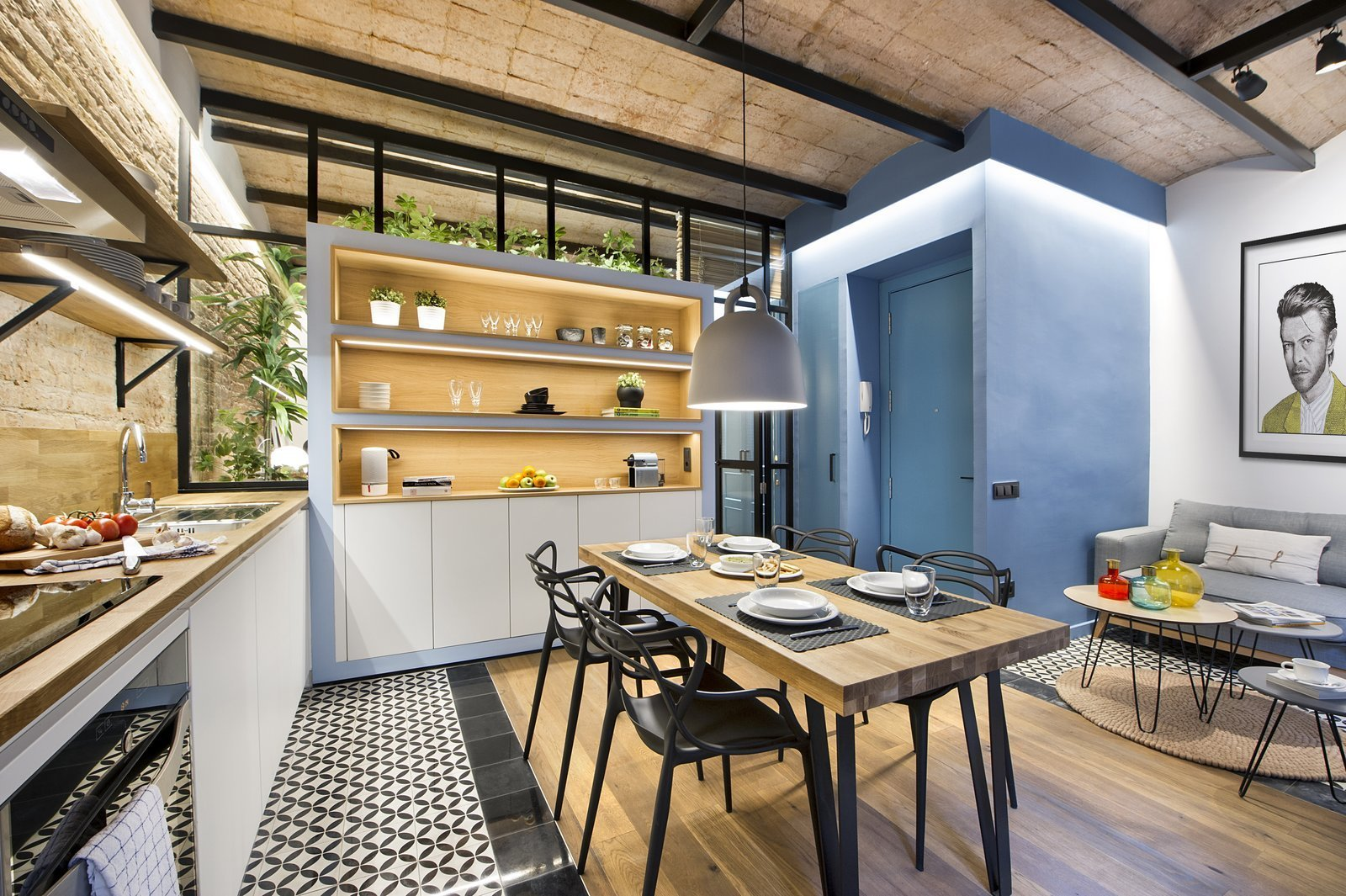 Tagged: Dining Room, Chair, Pendant Lighting, Ceiling Lighting, Table, Light Hardwood Floor, and Ceramic Tile Floor.  Photo 4 of 11 in A Smart Layout Maximizes Space in This Compact Urban Beach Apartment in Barcelona