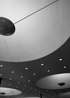 Ode to a Forward-Thinking America: Columbus, Indiana - Photo 4 of 18 - Saarinen's overhead lighting was unusual: Concave expanses hold custom fixtures, while a constellation of smaller embedded bulbs plays up the feeling of space.