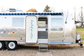 These 7 Vintage Airstreams Were Transformed Into Modern Escapes - Photo 3 of 8 - Designer and writer Lynne Knowlton revamped her 1976 Airstream with a playful edge.