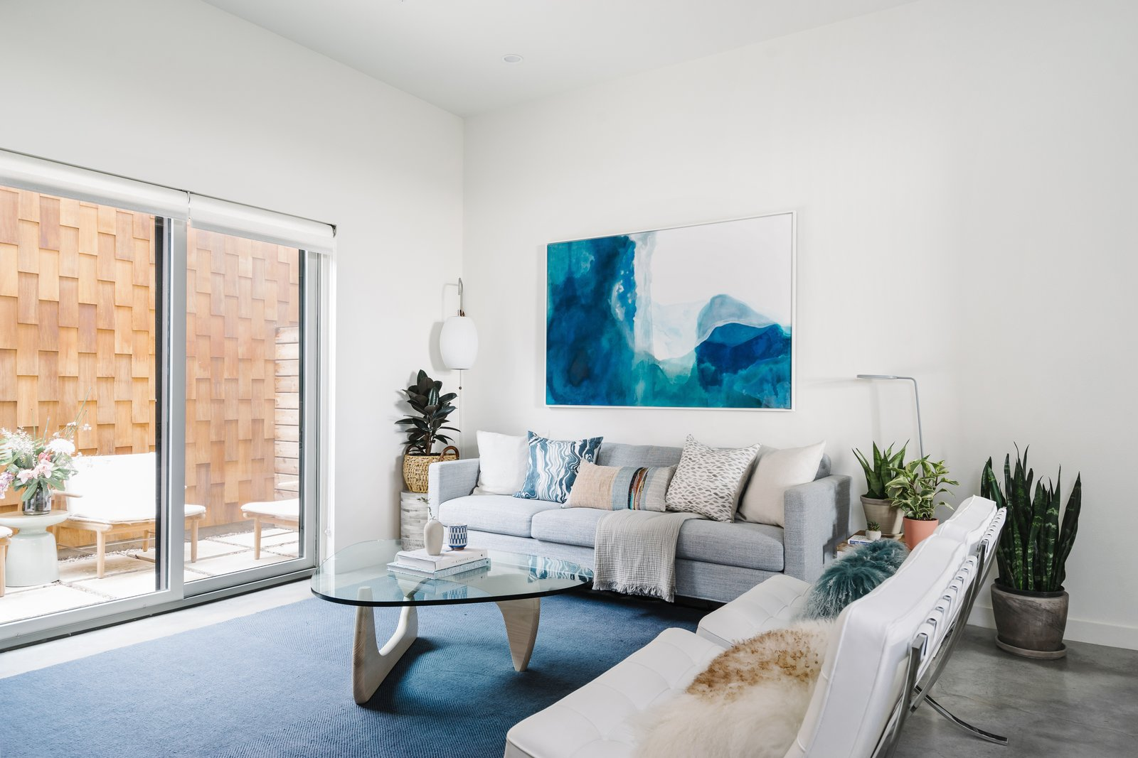Tagged: Living Room, Chair, Lamps, End Tables, Sofa, Coffee Tables, Concrete Floor, and Floor Lighting. St. Barts-Inspired Accents Create Modern Tranquility in an Austin Tilley Row Home - Photo 1 of 7