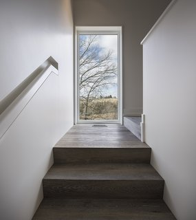 An Artist and Farmer Work With a Toronto-Based Studio to Build a Barn-Inspired Home - Photo 6 of 11 - The flooring and stair treads are by Northern Wide Plank.