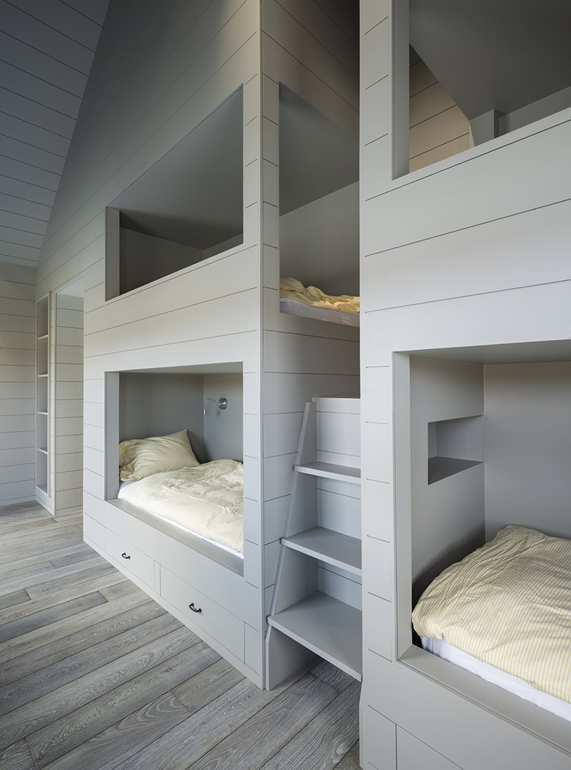 LAMAS designed a quartet of bunkbeds large enough for adults. Tagged: Bedroom, Medium Hardwood Floor, Bunks, Bed, and Storage. An Artist and Farmer Work With a Toronto-Based Studio to Build a Barn-Inspired Home - Photo 11 of 12