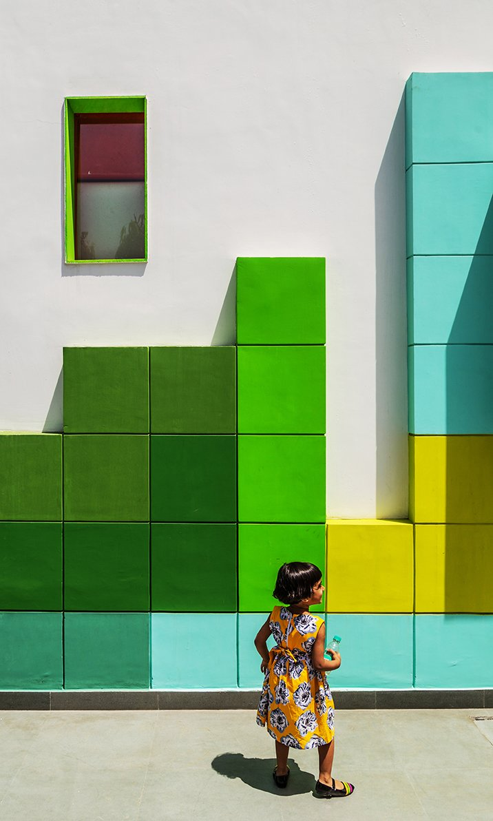 "The facade of the building, which is known as ""The Tetrisception,"" is decorated with a series of 17.5-inch-square plastered brick cubes, a low-cost design technique.  Photo 2 of 2 in A Dilapidated Home in New Delhi Is Transformed Into a School That Fosters Creativity"