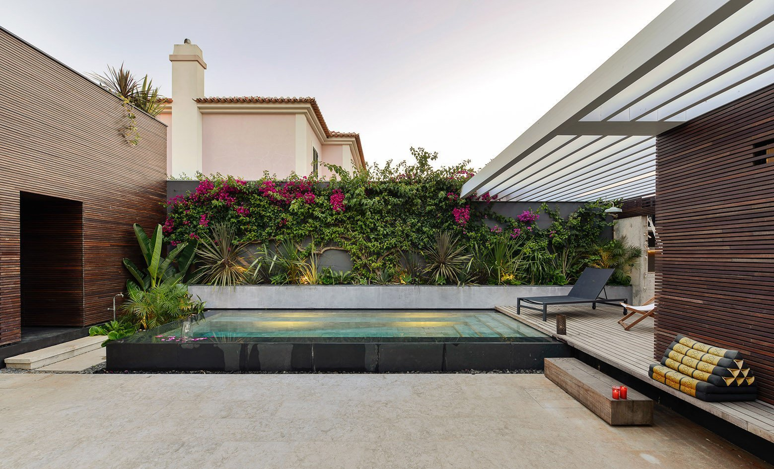 Tagged: Outdoor, Back Yard, Decking Patio, Porch, Deck, Gardens, Small Pools, Tubs, Shower, Swimming Pools, Tubs, Shower, and Infinity Pools, Tubs, Shower.  Photo 8 of 16 in An Architect Renovates His 1920s Home in Portugal, While Preserving the Exterior Shell