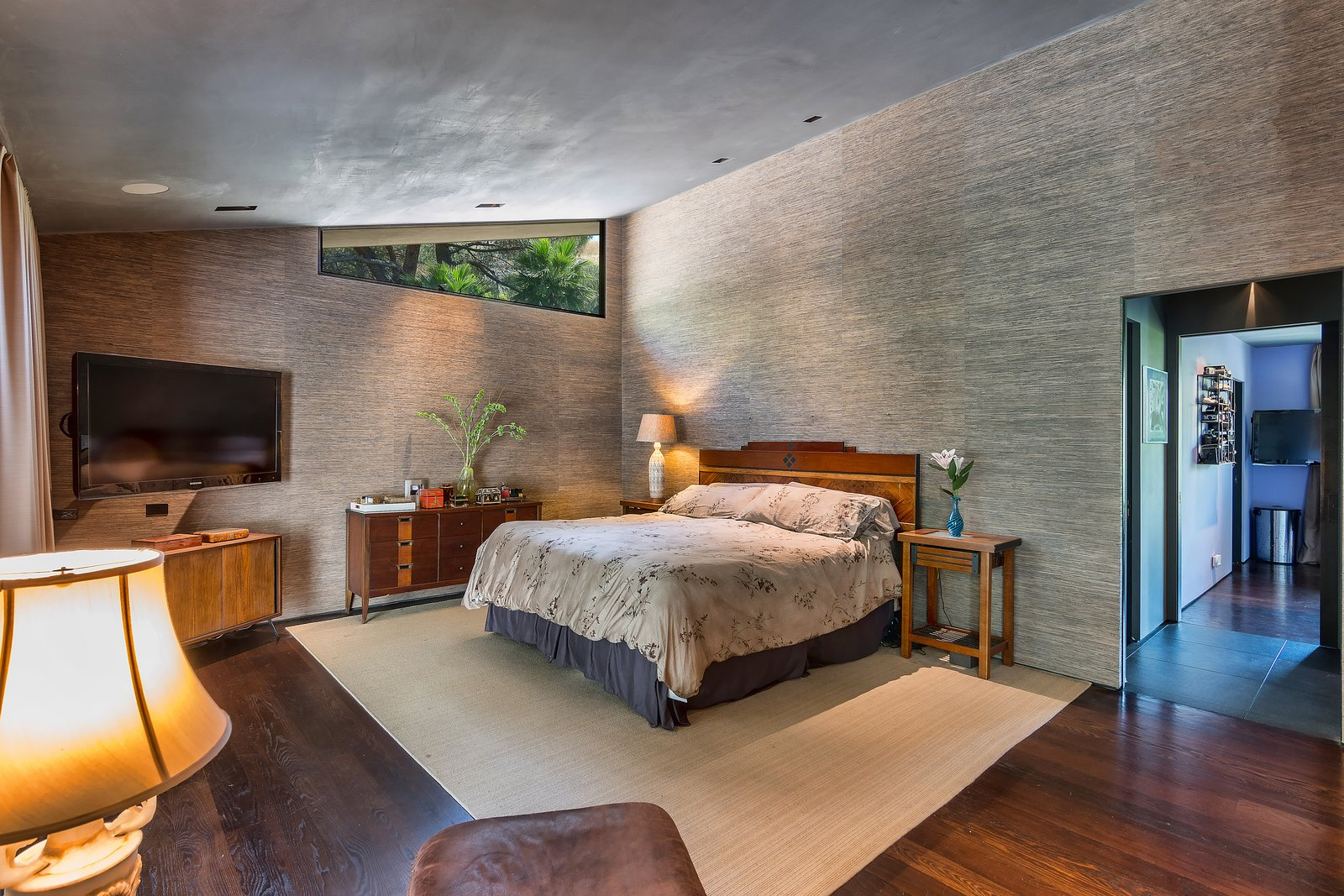 Tagged: Bedroom, Recessed Lighting, Bed, Night Stands, Medium Hardwood Floor, Dark Hardwood Floor, and Dresser.  Photo 7 of 14 in John Legend and Chrissy Teigen's Former Midcentury Home in the Hollywood Hills Is For Sale