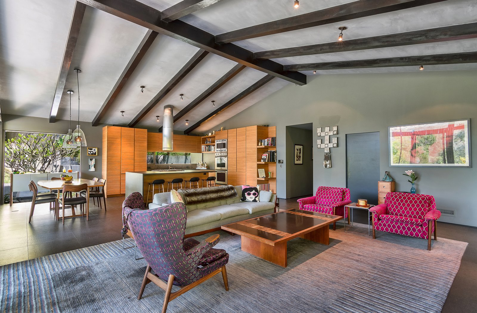 Tagged: Living Room, Chair, Coffee Tables, Sofa, and Ceiling Lighting.  Photo 4 of 14 in John Legend and Chrissy Teigen's Former Midcentury Home in the Hollywood Hills Is For Sale