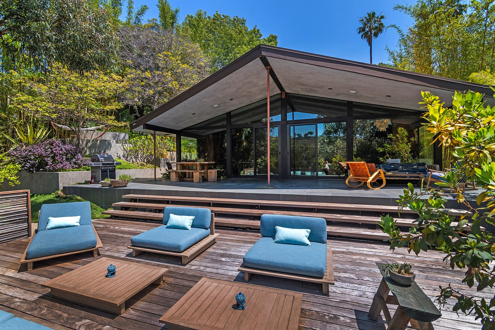 Tagged: Outdoor, Large Patio, Porch, Deck, Back Yard, Wood Patio, Porch, Deck, and Trees. John Legend and Chrissy Teigen's Former Midcentury Home in the Hollywood Hills Is For Sale - Photo 13 of 14