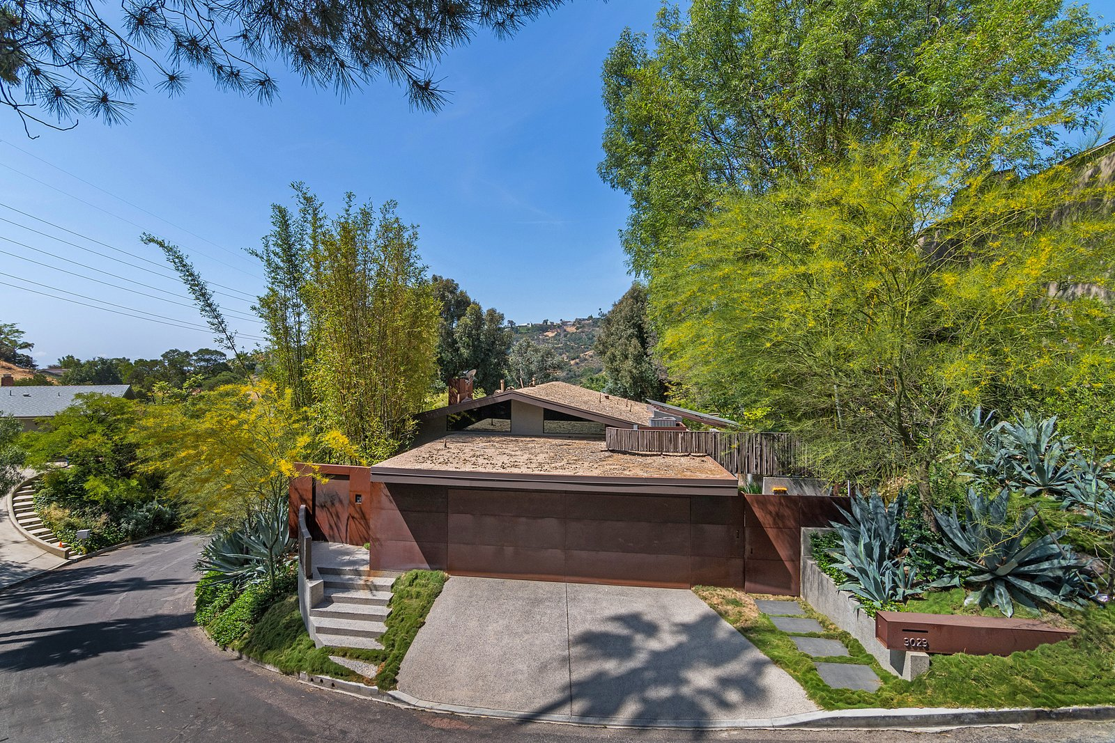 Tagged: Outdoor, Trees, and Grass.  Photo 2 of 14 in John Legend and Chrissy Teigen's Former Midcentury Home in the Hollywood Hills Is For Sale