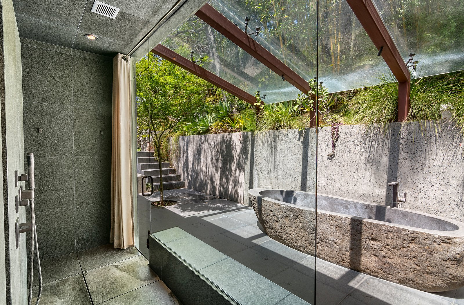 Tagged: Bath Room, Freestanding Tub, Soaking Tub, Open Shower, and Ceiling Lighting.  Photo 9 of 14 in John Legend and Chrissy Teigen's Former Midcentury Home in the Hollywood Hills Is For Sale